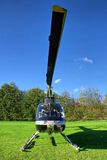 Small private helicopter on grass Stock Photo