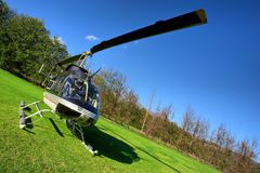 Small private helicopter on grass Stock Photography