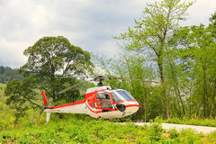 Small private helicopter on grass Royalty Free Stock Photos