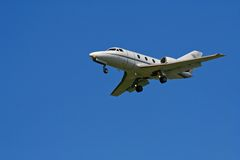 Small private jet on blue sky Stock Image
