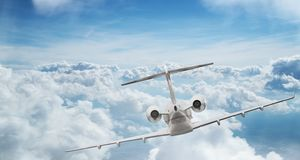 Small private jetplane flying above beautiful clouds. Royalty Free Stock Photography