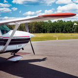 Small private plane in airport ready to take off Royalty Free Stock Images