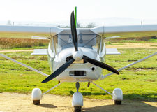 A small private plane close-up. Small plane landed in a field Royalty Free Stock Photos
