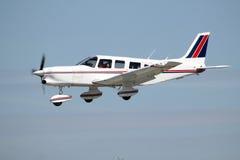 Small private plane landing Stock Photo