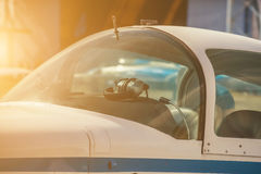 A small private plane with propeller stands at the airport, in bright, sunny day. Royalty Free Stock Photography