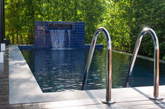 Small private pool in the house. With small waterfall royalty free stock photo