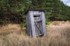 Chernobyl exclusion area. Small privy in abandoned Masheve settlement, Chernobyl Exclusion Zone, Ukraine Stock Images