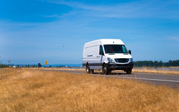 Small pro commercial cargo mini van on spectacular road Royalty Free Stock Images