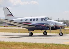 Small prop plane. A small private prop plane taxing by on ramp stock photography