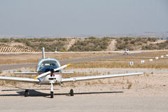 Small propeller airplane. A small propeller airplane and an autogyro in Casarrubios airfield (Spain Stock Photo