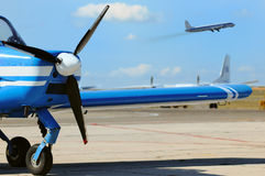 Small propeller airplane at the airfield Stock Photos