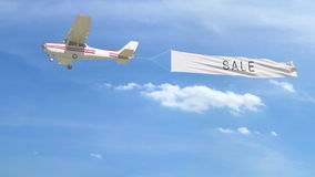 Small propeller airplane towing banner with SALE caption in the sky. 3D rendering Stock Photo
