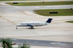 Small propeller plane on runway. Raytheon Beech 1900D turboprop for regional flights Stock Photography