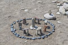 Little Stonehenge made of stones on the beach stock photo