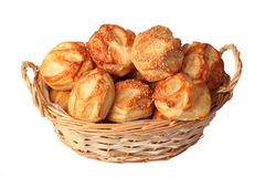 Small puff pastries in a basket Stock Images
