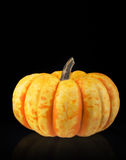 Small pumpkin on black background. Small pumpkin isolated on black background Stock Photo