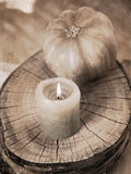 Small pumpkin and burning candle Stock Photography