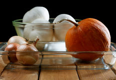 Small pumpkin and onions in aplate Stock Photography