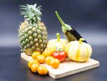 Small pumpkin, oranges and eggplant Stock Photo