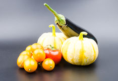 Small pumpkin, oranges and eggplant Stock Photography
