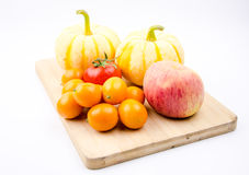 Small pumpkin, oranges and tomatoes Stock Photography