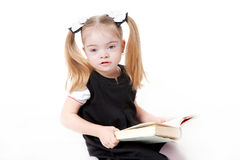 Small pupil reading book. Stock Photo