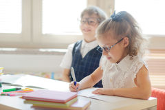 Small pupils in the lesson. Royalty Free Stock Images