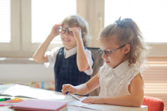 Small pupils in the lesson. Stock Image