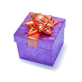 Small purple gift box with a bow. On top Stock Photos
