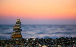 Small pyramid from stones on seacoast. Small pyramid from stones on the seacoast Royalty Free Stock Photo