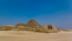 Small pyramids - panoramic view. Ruined small pyramids and desert in Giza, Cairo, Egypt - panoramic view Stock Photos