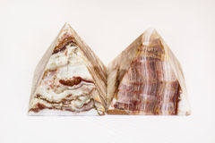 A small pyramids. Two marble pyramids -close up   on a white background Royalty Free Stock Photography