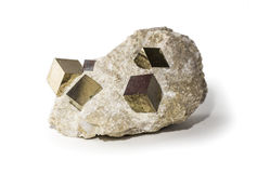Small pyrite or fool`s gold rock. Pyrite or fool`s gold crystals in stone placed on white background. Horizontal studio shot Royalty Free Stock Photography