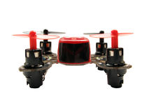 Small quadcopter. Ultra small quadcopter isolated on white background. Shallow DOF stock image