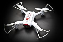Small Quadrocopter drone robot studio work white Stock Image