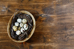 Small quail eggs in a basket, top view Royalty Free Stock Photography