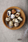 Small quail eggs in a bowl Stock Image