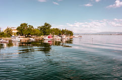Small quay with barks at sea lagoon Stock Image