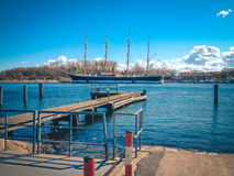 Small quiet marina  with large sailboat moored Stock Photography