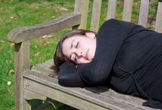 Small quiet nap on a bench Stock Image