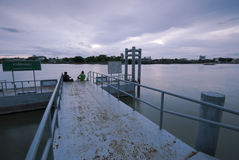 Small quiet pier in Bangkok, Thailand. Tok Road pier in Bangkok is mostly used by the local fishing boats and ferries stock photos