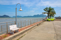 Small quiet quay on the shore of the Phang Nga bay.  Royalty Free Stock Photo