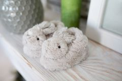 Small rabits for child. Cute little slippers, form of gray bunnies small rabbits. Goods for children. photo is perfect for magazines, shops dealing with toys Stock Photography