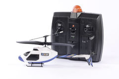 Small radio controlled helicopter toy. And remote control isolated on white background Stock Photos