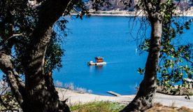 Free Small Raft With Cabin Floating On California`s Lake Cachuma Royalty Free Stock Photography - 105613487