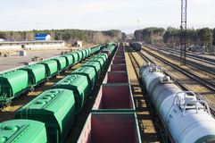 Small railway station. Carriages for transportation of bulk cargoes are awaiting loading. Stock Photos