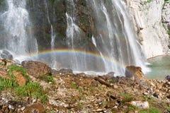 Small rainbow in Gega waterfall, Ritsa Relic National Park, Abkhazia stock photography