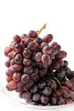 Small ranch of fresh red grape. Isolated on white background. Close-up. Studio photography Stock Image