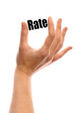 Small rate. Vertical shot of a hand holding the word Rate between two fingers, isolated on white Royalty Free Stock Image