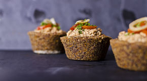 Small raw food quiche royalty free stock image